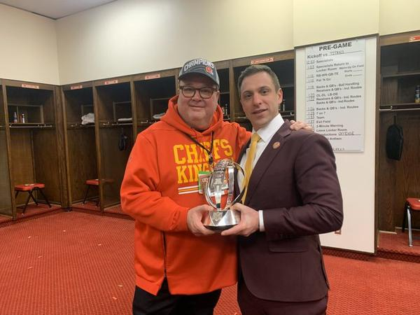 Actor Eric Stonestreet with Chiefs General Manager Brett Veatch.