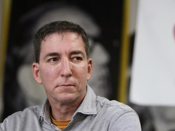 Journalist Glenn Greenwald, shown here during a press conference last July, has been accused by Brazilian federal prosecutors in a hacking probe.