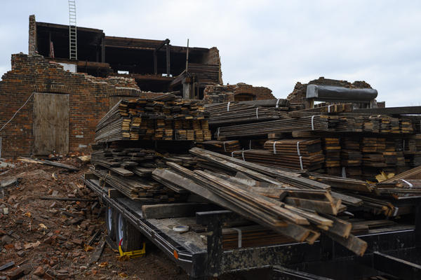 For about six months last year, the St. Louis Development Corporation hired workers to carefully take apart a former storage warehouse in the Vandeventer neighborhood and saved lumber, brick and other materials for reuse.