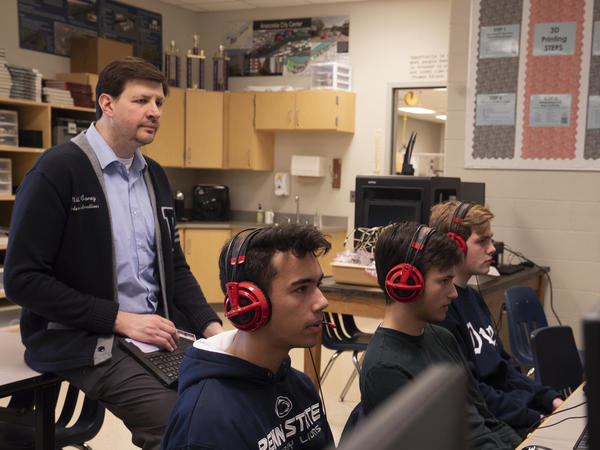 Assistant Principal Miles Carey oversees a Rocket League practice at Washington-Liberty High School in Arlington, Va.