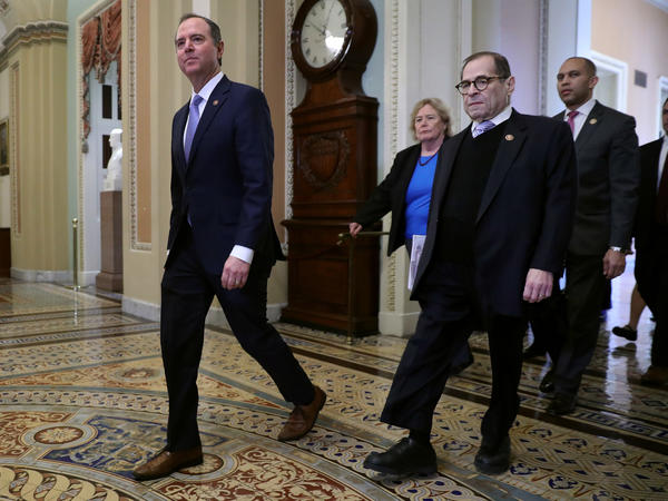 Impeachment managers (from left) Reps. Adam Schiff, Zoe Lofgren, Jerry Nadler and Hakeem Jeffries head toward the Senate chamber for the start of President Trump's impeachment trial Wednesday.