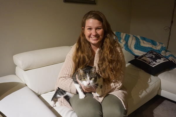 Katie Bartels and her emotional support cat, Hank, who was certified as an ESA by a therapist, not an online service.