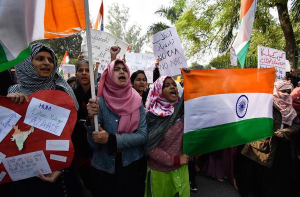 Demonstrators protest against the Citizenship Amendment Act near Jamia Millia Islamia on Dec. 15 in New Delhi.