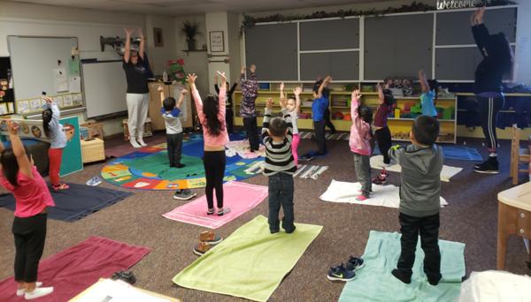 Children practice yoga at the Kansas Children's Service League's Head Start program in Garden City.