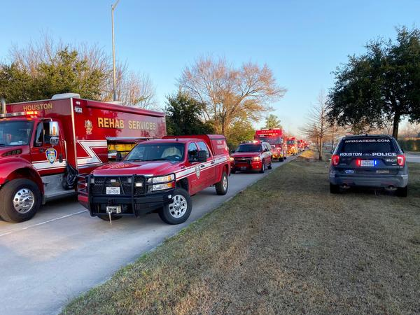 Emergency personnel work the scene of the early morning explosion that Houston Fire Chief Samuel Peña said caused significant damage to nearby homes and even knocked some off their foundations.