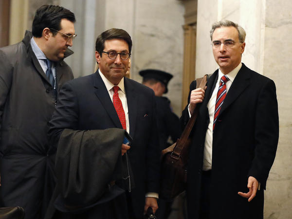 President Trump's personal attorney Jay Sekulow (center) stands with his son, Jordan Sekulow (left), and White House counsel Pat Cipollone in the Capitol on Saturday.