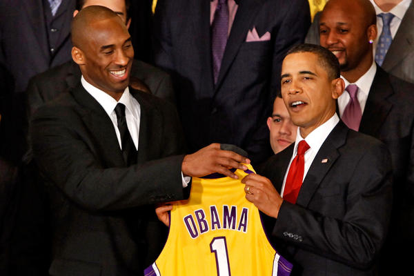 Bryant presents a jersey to President Barack Obama at the White House during an event to celebrate the Lakers' 2009 NBA championship.