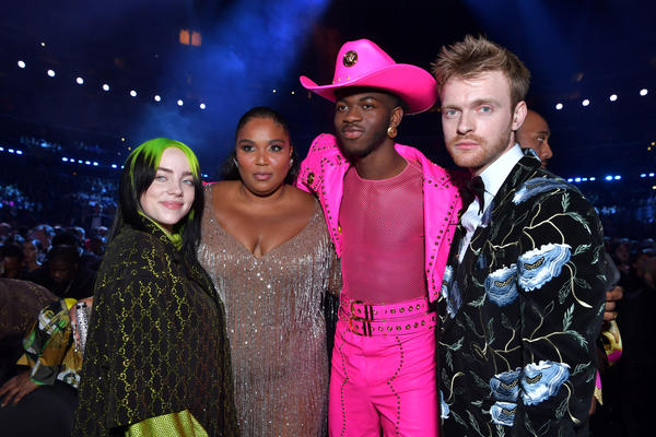 Four of the most-nominated artists at the 62nd annual Grammy Awards — (from left to right) Billie Eilish, Lizzo, Lil Nas X, and Finneas O'Connell — pose in the audience during the broadcast.
