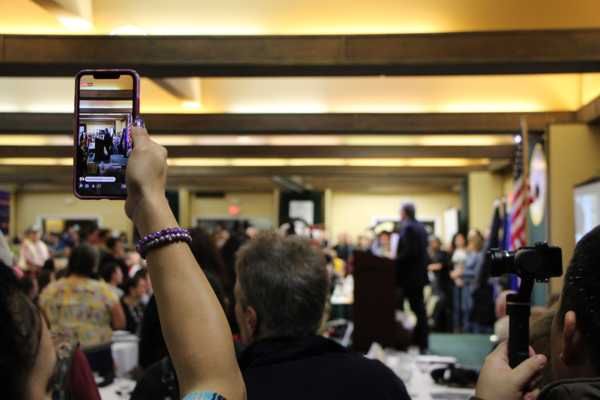 A crowd watches as Montana Govenor Steve Bullock addresses the audience at the celebration for the Little Shell Tribe's federal recognition on January 25, 2020.