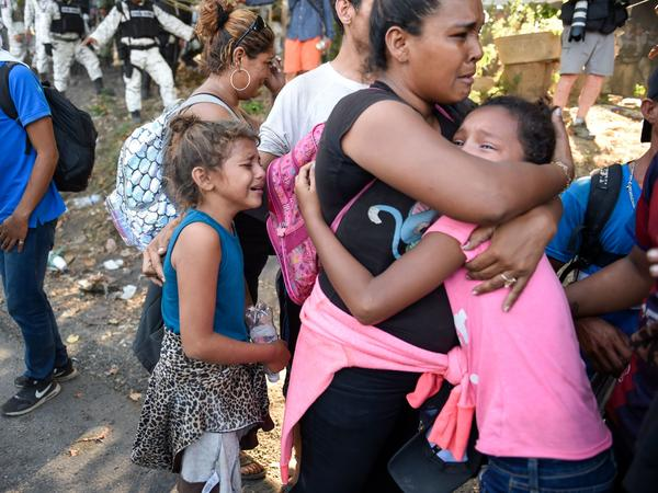 A Central American migrant family reacts after members of the Mexican National Guard prevent them from continuing on their way in Ciudad Hidalgo, Chiapas State, Mexico on Jan. 23.
