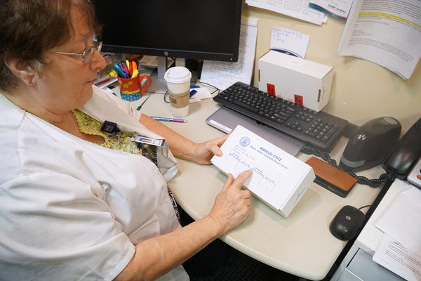 Kathy Howard, who has worked as a sexual assault nurse examiner for decades, shows an unused rape kit.