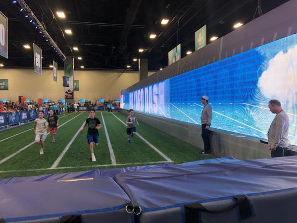 Kids run a 40-yard dash at the Super Bowl Experience event at the Miami Beach Convention Center on Sunday.