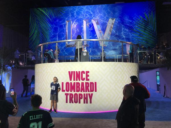 People waited in line up to two hours to take a photo with the Vince Lombardi trophy, which is given to the Super Bowl winner each year.