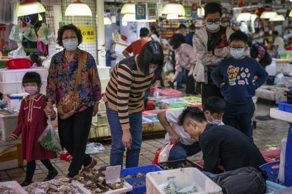 Many customers wear face masks.