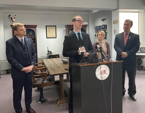 Illinois State Board of Elections Cybersecurity Officer Neil Herron (center) joins Tazewell County Clerk John Ackerman (left) and other county election officials at a press conference Jan. 30, 2020.