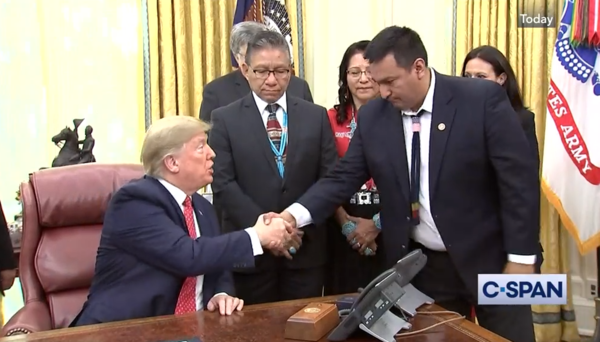 President Trump and Crow Chariman AJ Not Afraid shake hands during their meeting on November 26, 2019.