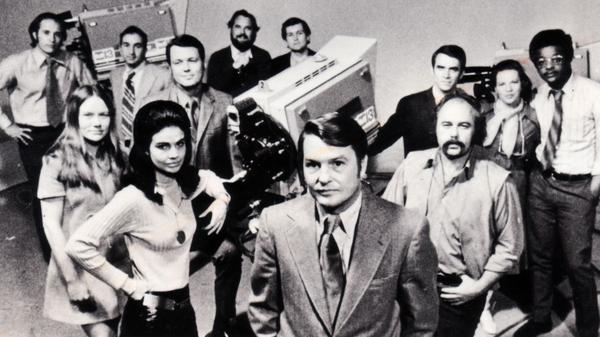 """Jim Lehrer (center) with colleagues from KERA-TV's """"Newsroom,"""" which aired in the 1970s."""