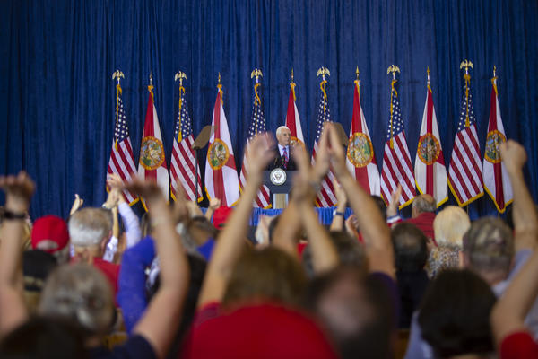 Crowds gather at a campaign rally in Tampa with Vice President Mike Pence