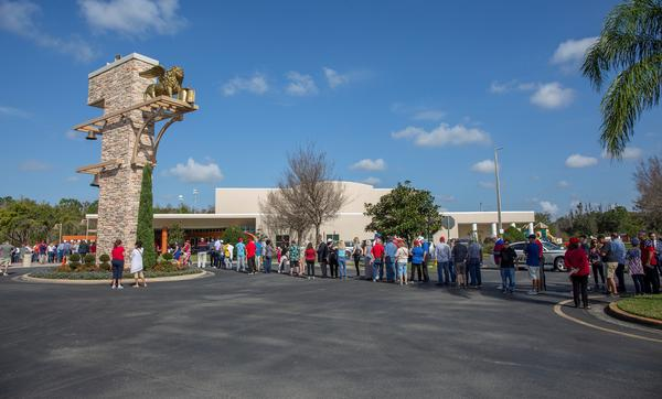 Crowds line up to get in to see Vice President Mike Pence at a Trump 2020 campaign rally.
