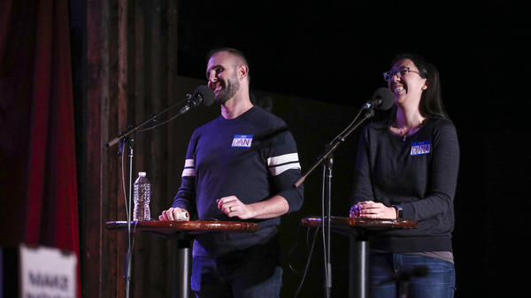 Contestants Dan Predoehl and Diana Hirota play games on <em>Ask Me Another</em> at the Bell House in Brooklyn, New York.