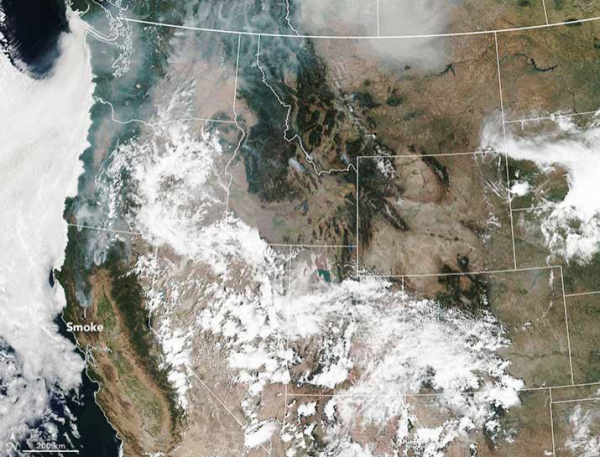 Plumes of smoke from wildfires spread across the West in this image from August 2018.