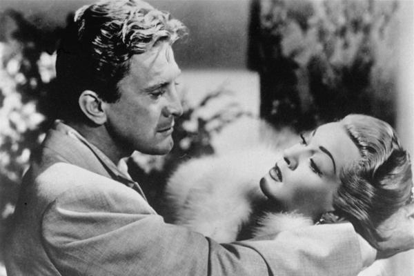 Douglas and Lana Turner dance in a scene from Vincente Minnelli's 1952 film, <em>The Bad and the Beautiful.</em>