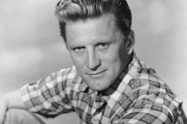 """Actor Kirk Douglas, shown above at 39, was born Issur Danielovitch in New York to Russian Jewish parents. He would later tell his own children that they didn't have his """"advantage of being born into abject poverty."""""""