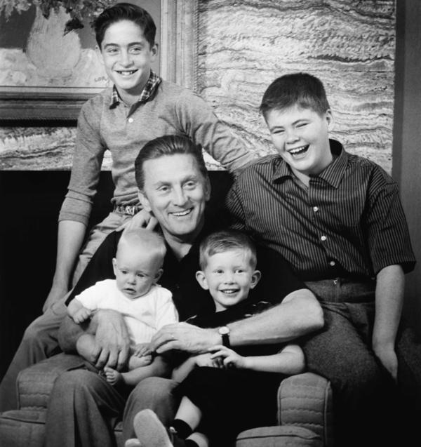 """Douglas was the patriarch of """"The Douglas Dynasty,"""" a phrase coined by the media to describe the family's star power. Here, Douglas poses in 1959 with his four sons, Eric (bottom left), future actor Michael (top left), Peter (bottom right) and future producer Joel (top right)."""