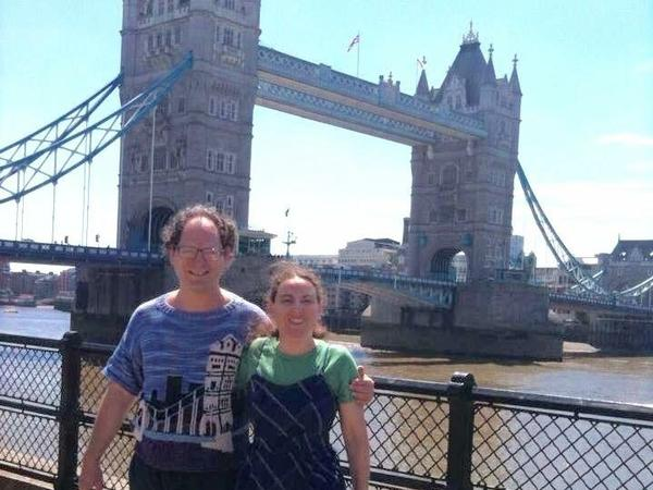 Barsky shows off his London's Tower Bridge with his matching sweater creation, alongside his wife, Deborah.