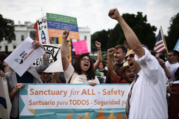 Immigrants and supporters demonstrate during a rally in support of the Deferred Action for Childhood Arrivals program in front of the White House on Tuesday.