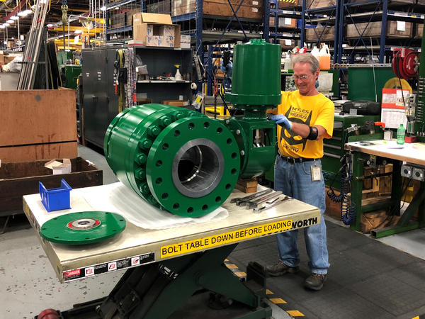 A worker assembles an industrial valve at Emerson Electric Co.'s factory in Marshalltown, Iowa. The manufacturing sector has seen a slowdown amid the ongoing trade war.