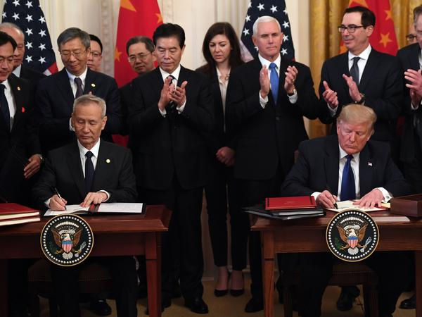 "President Trump and Vice Premier Liu He, China's top trade negotiator, sign a ""Phase 1"" trade agreement between the U.S. and China at the White House on Wednesday."