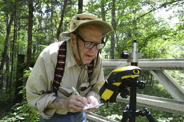 Bob Vollmer, seen in a 2016 photograph provided by the Indiana Department of Natural Resources, shows the now-102-year-old at work. The state's oldest employee plans to retire next month, after nearly six decades on the job.