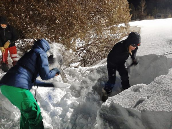 Students shovel snow as a team while attending an avalanche rescue class near Park City, Utah.