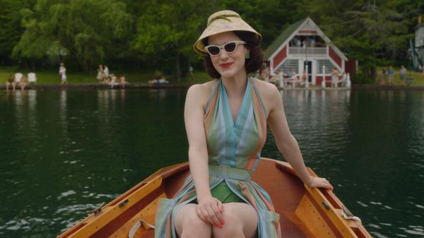 """In the second season of <em>The Marvelous Mrs. Maisel,</em> Midge (Rachel Brosnahan) visits the Catskills. Costume designer Donna Zakowska says this outfit """"in the boat with a funny lampshade hat"""" was among her favorites."""