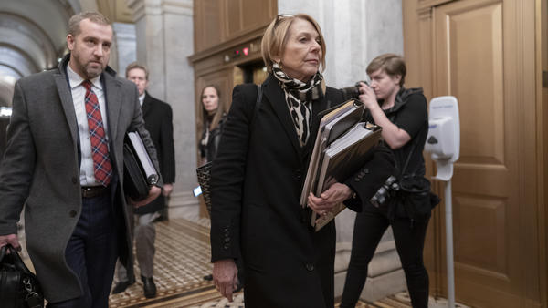 Jane Raskin, a lawyer defending President Trump in his impeachment trial, departs the Senate following opening arguments Saturday.