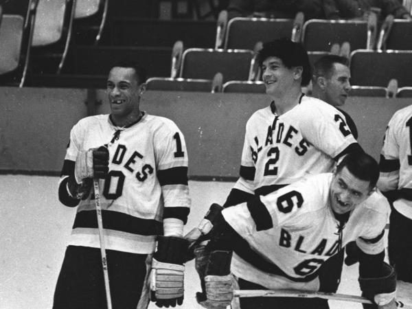 Willie O'Ree (left) and Howie Young (center) of the Los Angeles Blades talk during warm ups before their game at the Los Angeles Sports Arena during the 1963-64 season in Los Angeles, Calif. O'Ree became the first black player in the National Hockey League when he joined the Boston Bruins in 1958.