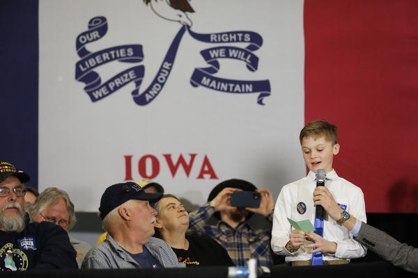 Edward Kennedy, 11, of Waukee, Iowa, and mayor of his school, asks Democratic presidential candidate Pete Buttigieg — former mayor of South Bend, Ind. — a question about climate change at a town hall in Winterset on Jan. 13.