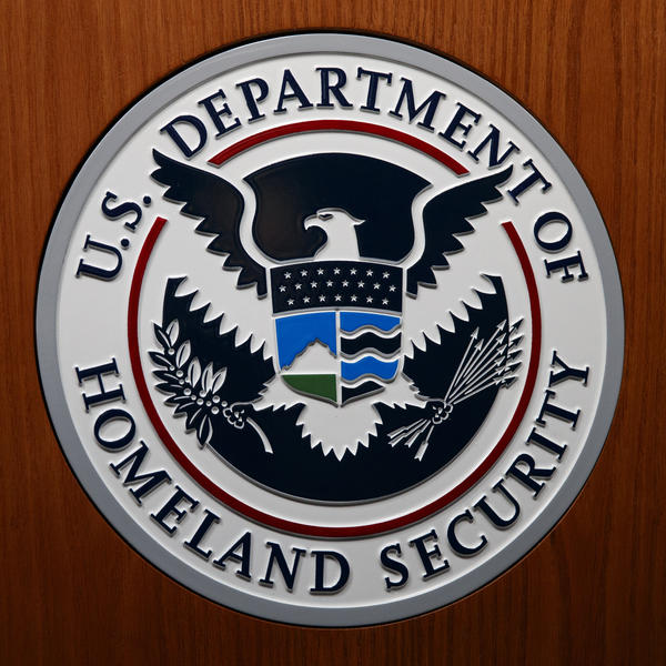 The Department of Homeland Security (DHS) seal is a photograph taken in Washington, D.C., in June.