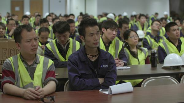 Chinese workers at Fuyao Glass America attend training to learn about American culture.
