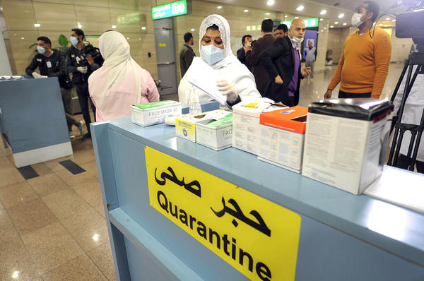 Employees of the Egyptian Quarantine Authority prepare to scan the body temperature of incoming travelers at Cairo International Airport.