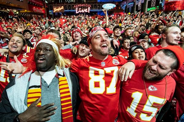 "The large crowd at KC Live! sings along to ""We Are The Champions"" after the Chiefs' Super Bowl victory."