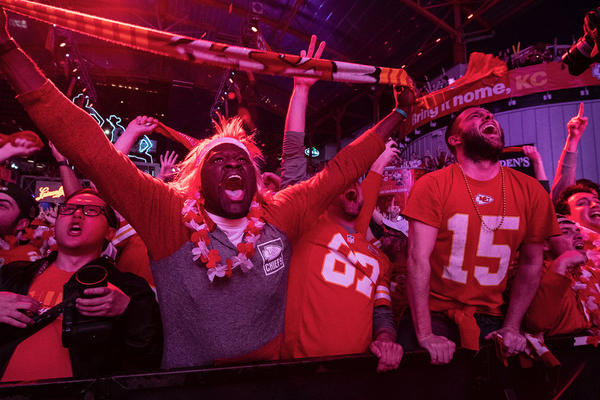 Chiefs fans at KC Live! in downtown Kansas City go crazy over Patrick Mahomes' touchdown in the first quarter of the Super Bowl.