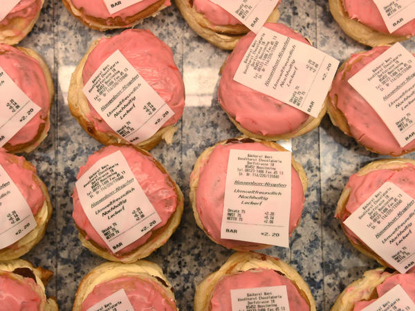 Doughnuts with a receipt made of fondant were on display last week at a bakery in Moosinning, Germany. These <em>Kassenbon Krapfen</em> — receipt doughnuts — are a reaction to Germany's new receipt law.