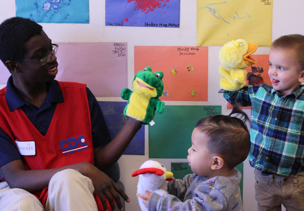 Project Search intern Genesis Coleman cares for children at the Child Development Center on McConnell Air Force Base.