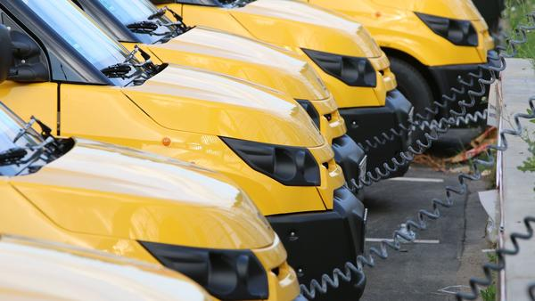 Electric vans charge at a warehouse of the German postal and logistics service Deutsche Post near Frankfurt in July 2018. Fleet vehicles are increasingly going electric in Europe and China, and some analysts say American fleets will be following suit.