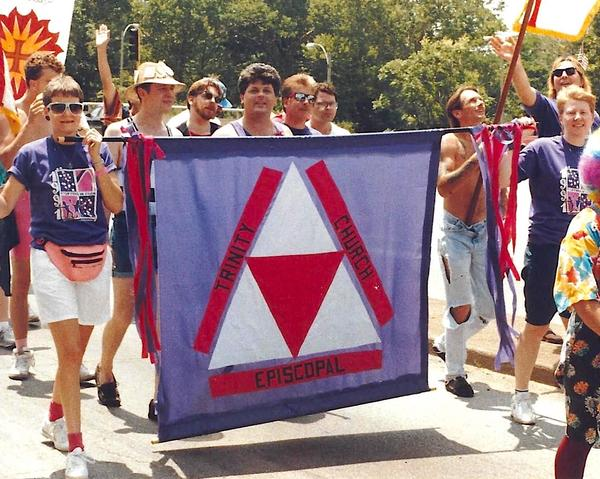 People carrying a Trinity Episcopal Church banner at the St. Louis Pride Parade in 1991.