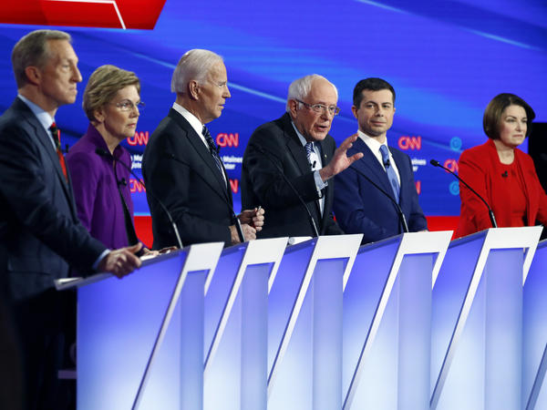 Democratic presidential candidate Sen. Bernie Sanders (center) speaks as fellow candidates businessman Tom Steyer (from left), Sen. Elizabeth Warren, former Vice President Joe Biden, former South Bend Mayor Pete Buttigieg and Sen. Amy Klobuchar, listen on Jan. 14, during a Democratic presidential debate. Andrew Yang will also be on stage Friday.