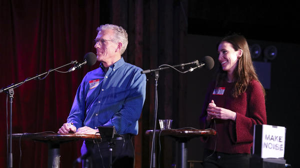 Contestants Randolph Meiklejohn and Meredith Lark face off in a game on <em>Ask Me Another</em> at the Bell House in Brooklyn, New York.