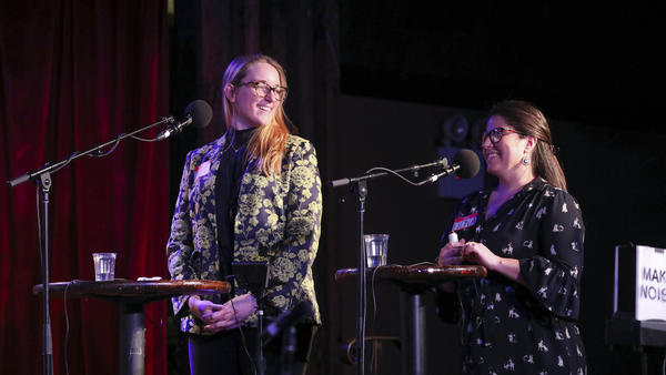 Contestants Jamie Wernet and Fiona Finlay-Hunt play games on <em>Ask Me Another</em> at the Bell House in Brooklyn, New York.